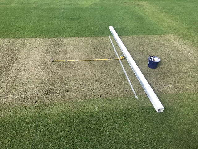 Marking out a cricket pitch