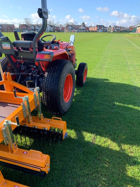 grooming a football pitch